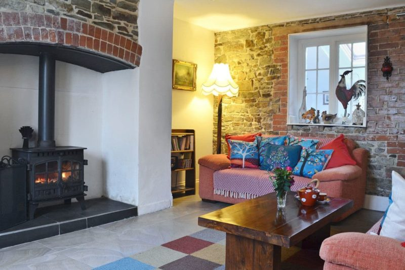Warm and welcoming living room with cosy wood burner | North Park Cottage, Ashwater, near Holsworthy