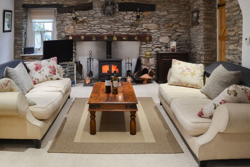 Warm and welcoming living room with imposing fireplace   Lynton Cottage, Combe Martin