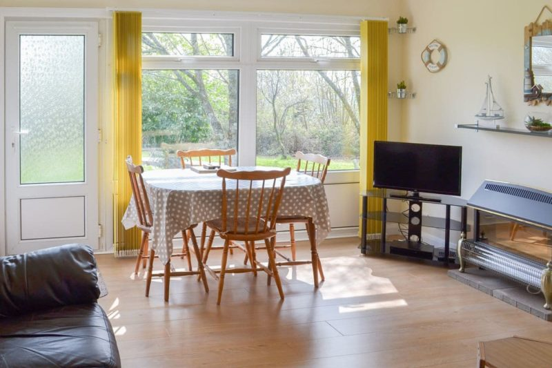 Modest dining area with lovely outlook | Seahaven, Dartmouth