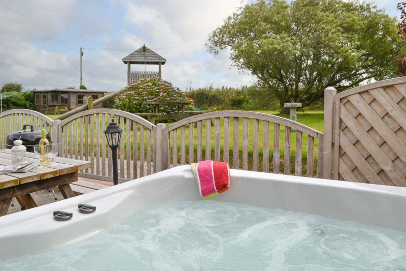 Relaxing private hot tub | The Old Mill House, Welcombe, near Bude