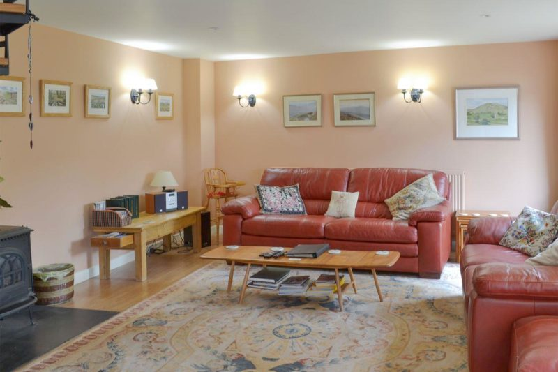 Delightful open plan living space with spiral staircase | Cherry Tree Cottage, Bovey Tracey