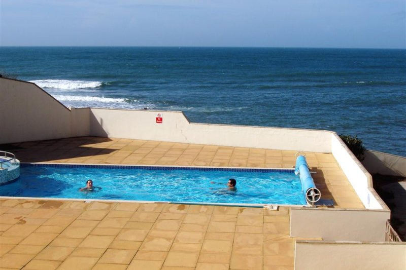 The pool and terrace, with direct private access leading down to the beach.