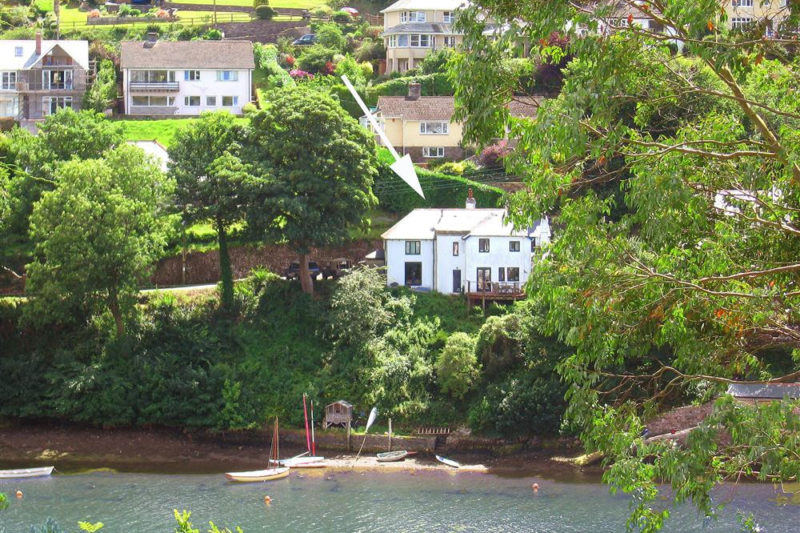 Yew Tree Cottage's fantastic waterside location with steps down to the water and mooring.