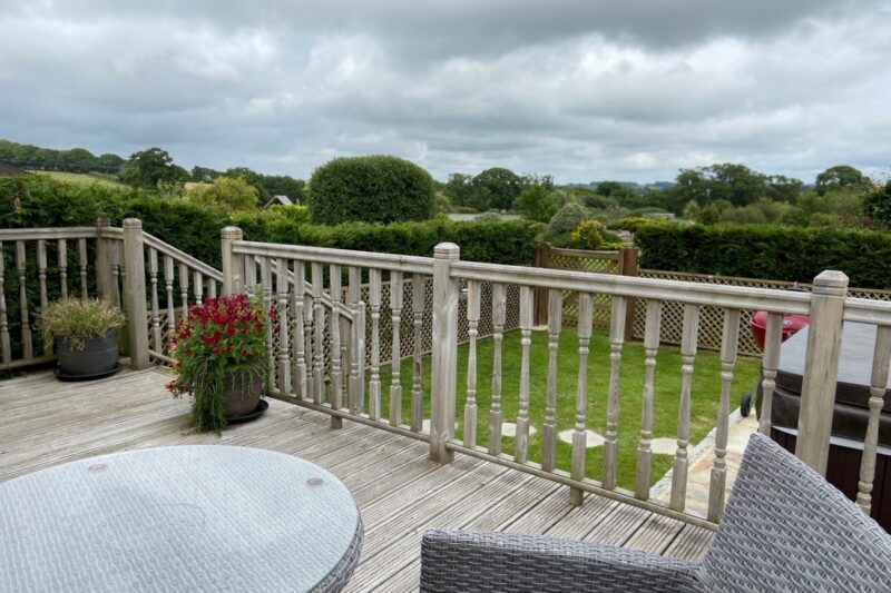 Decked area overlooking garden and hot tub, with countryside view