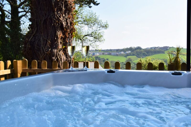 Relax in the hot tub in enclosed garden