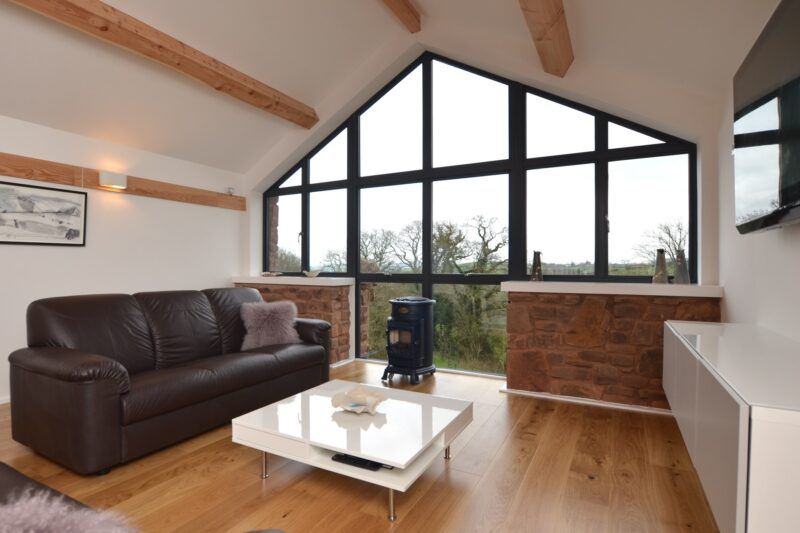 Lounge area with expansive countryside views