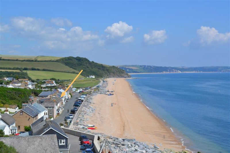 Beesands from the coastal path with the cottage arrowed. Since this photo storms have moved the beach towards the other end of the village.