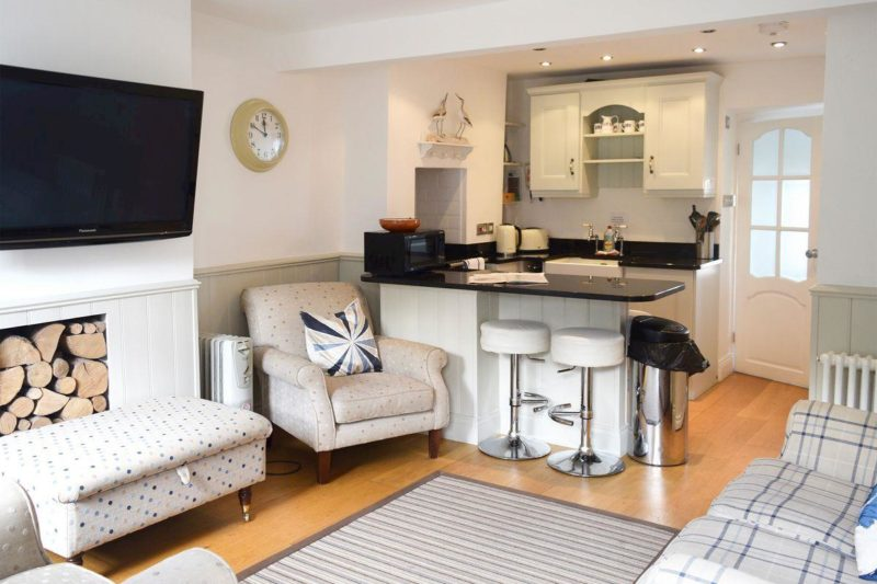 Open plan kitchen with breakfast bar and sitting room | Cooks Cottage, Salcombe