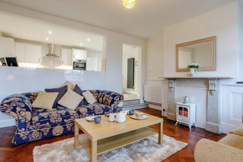Original parquet flooring and marble fireplace makes this a unique apartment