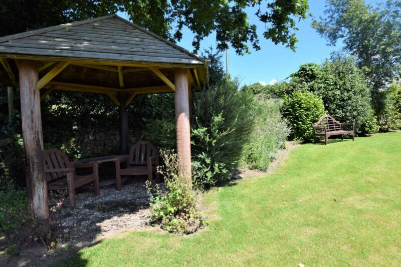 Shared garden with BBQ and play equipment