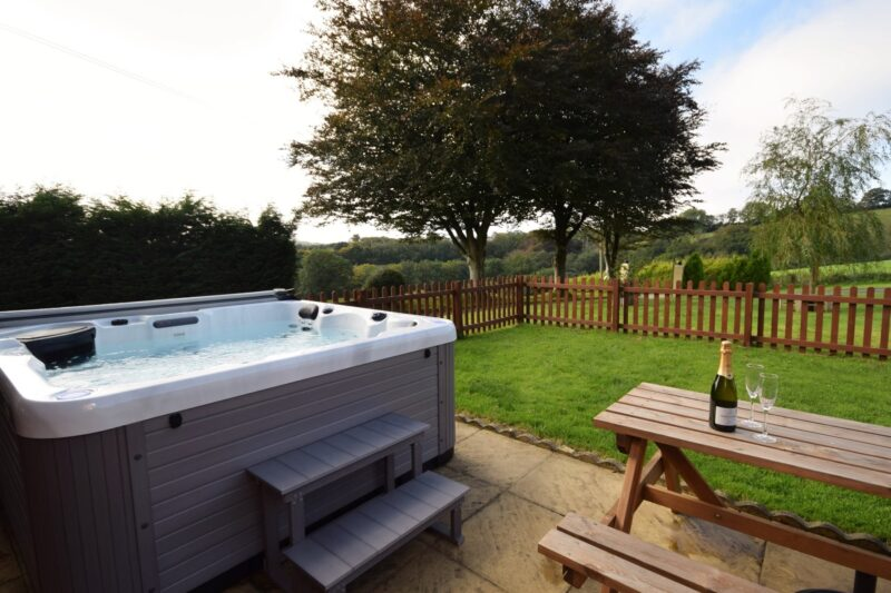Enjoy the countryside views from the hot tub