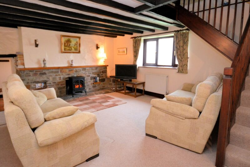 Relax in the spacious lounge then take the stairway to galleried master bedroom