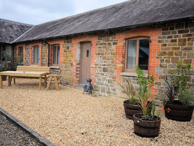 View towards the cottage with outside seating