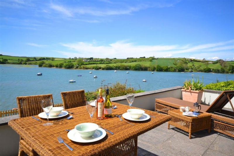 The terrace and garden at Cliff Crest have stunning panoramic waterside views