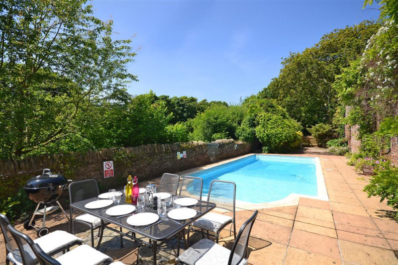 The solar heated swimming pool with quality outdoor table and chairs and Weber barbecue