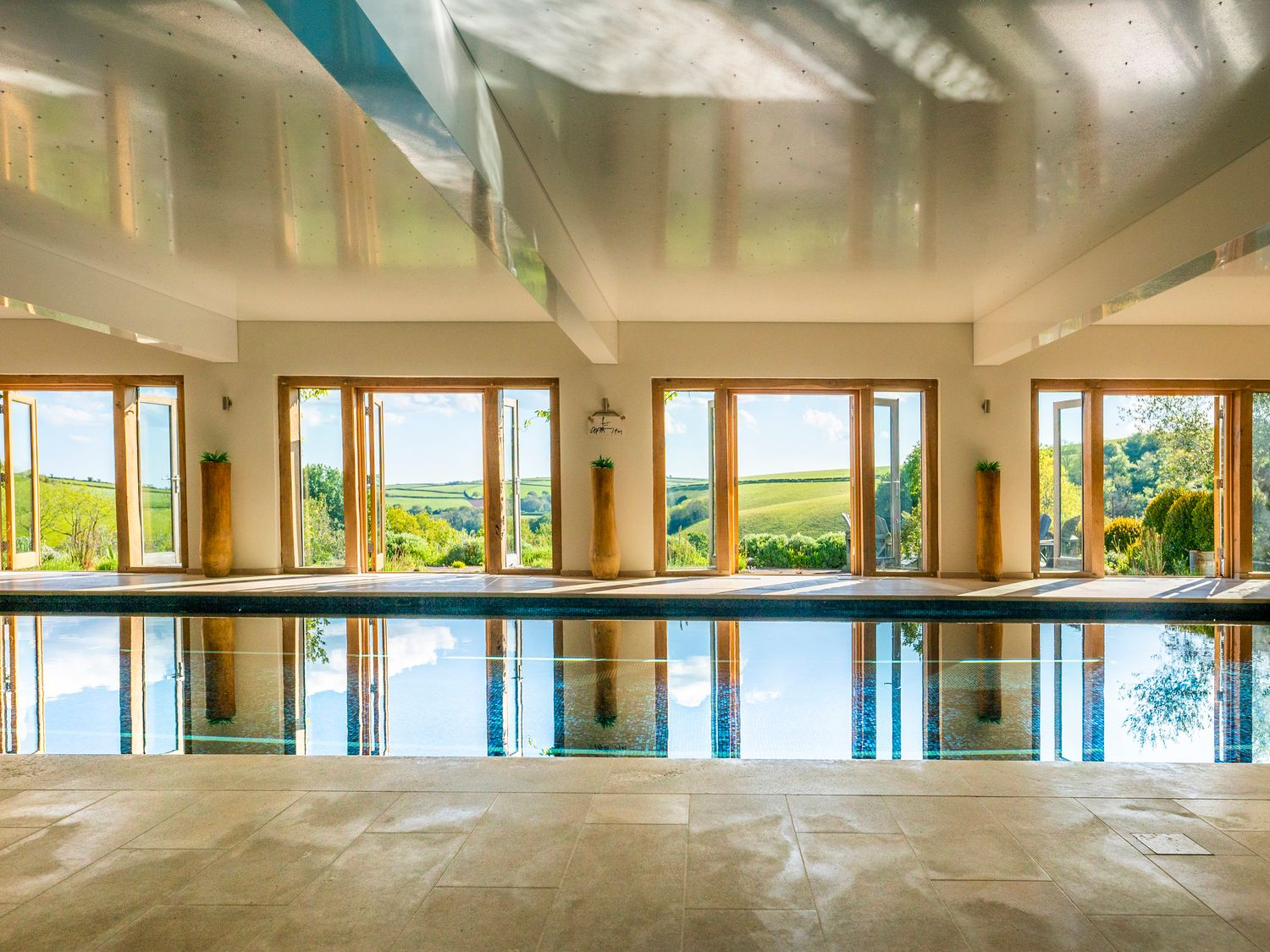 Indoor swimming pool with countryside views of Devon